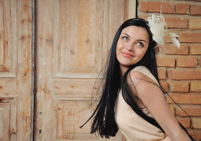 attractive beautiful brinette on old wooden door background, fashion beauty concept